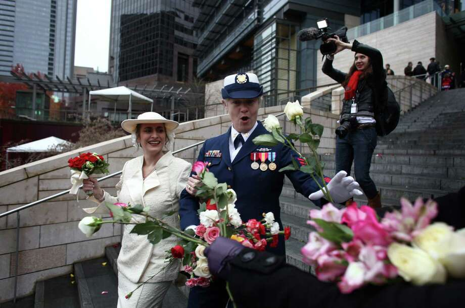 Deb Needham, left, and Nancy Monahan, a retired member of the U.S. Coast Guard, walk down the stairs of Seattle City Hall after they were married. Photo: JOSHUA TRUJILLO / SEATTLEPI.COM