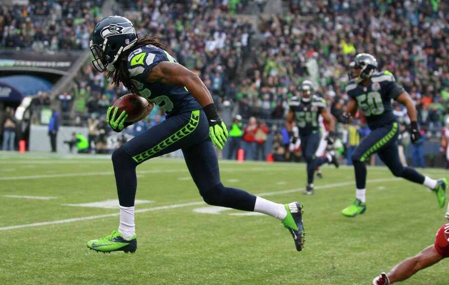 Seattle Seahawks cornerback Richard Sherman (25) returns an interception from Arizona Cardinals quarterback John Skelton for a 19-yard touchdown during the second quarter of an NFL football game in Seattle, Sunday, Dec. 9, 2012. Photo: AP