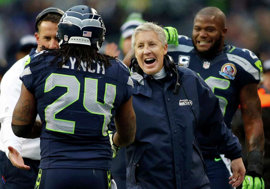 Seattle Seahawks head coach Pete Carroll congratulates running back Marshawn Lynch (24) after Lynch scored on a 20-yard touchdown run during the first quarter of an NFL football game against the Arizona Cardinals in Seattle, Sunday, Dec. 9, 2012. Photo: AP