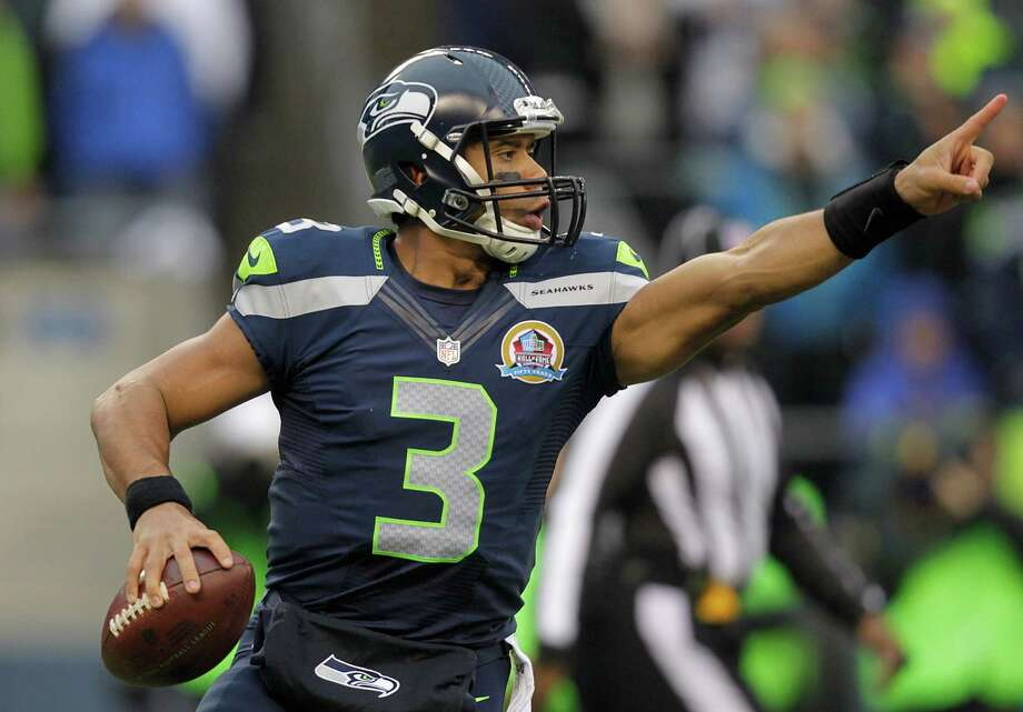 Seattle Seahawks quarterback Russell Wilson (3) passes against the Arizona Cardinals during the first quarter of an NFL football game in Seattle, Sunday, Dec. 9, 2012. Photo: AP