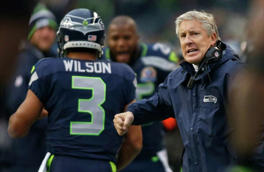 Seattle Seahawks head coach Pete Carroll, right, celebrates next to quarterback Russell Wilson (3) a