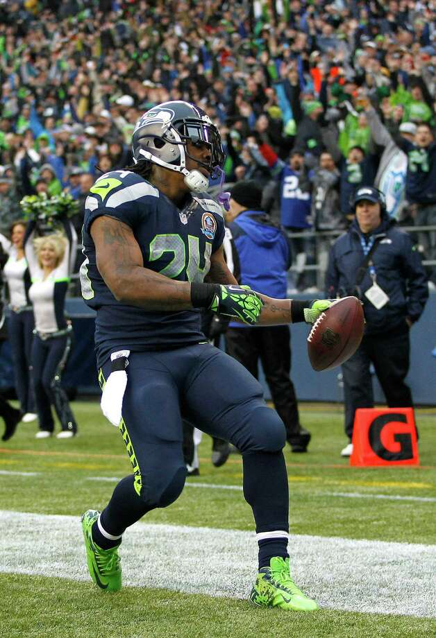 Seattle Seahawks running back Marshawn Lynch (24) scores on a 20-yard touchdown run against the Arizona Cardinals during the first quarter of an NFL football game in Seattle, Sunday, Dec. 9, 2012. Photo: AP
