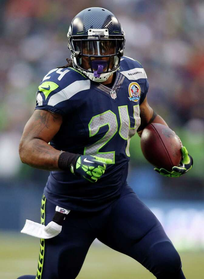 Seattle Seahawks running back Marshawn Lynch (24) runs for a 20-yard touchdown against the Arizona Cardinals during the first quarter of an NFL football game in Seattle, Sunday, Dec. 9, 2012. Photo: AP
