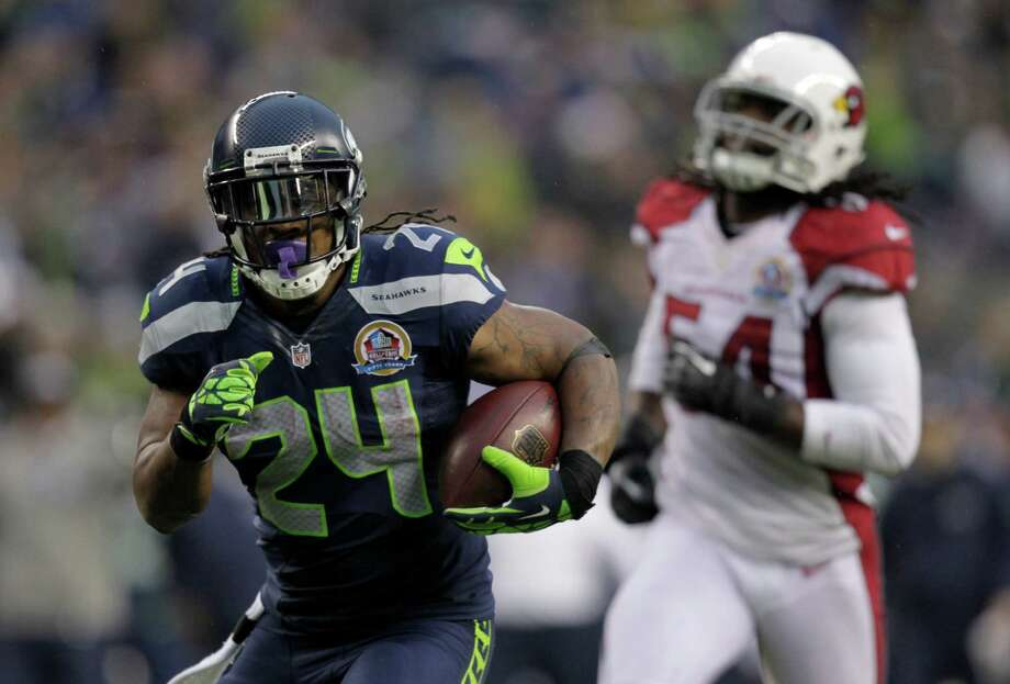Seattle Seahawks running back Marshawn Lynch (24) runs for a 33-yard touchdown against the Arizona Cardinals during the third quarterof an NFL football game in Seattle, Sunday, Dec. 9, 2012. Photo: AP