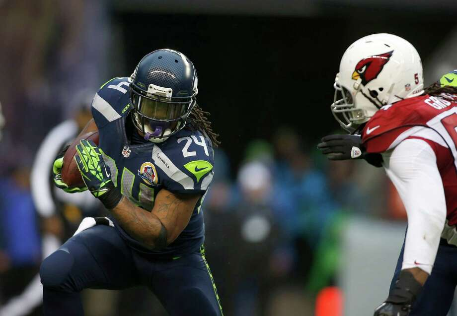 Seattle Seahawks running back Marshawn Lynch (24) runs against the Arizona Cardinals during the second quarter of an NFL football game in Seattle, Sunday, Dec. 9, 2012. Photo: AP