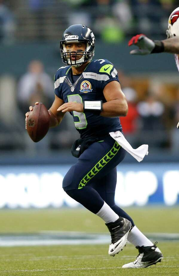 Seattle Seahawks quarterback Russell Wilson (3) passes against the Arizona Cardinals during the first half of an NFL football game in Seattle, Sunday, Dec. 9, 2012. Photo: AP