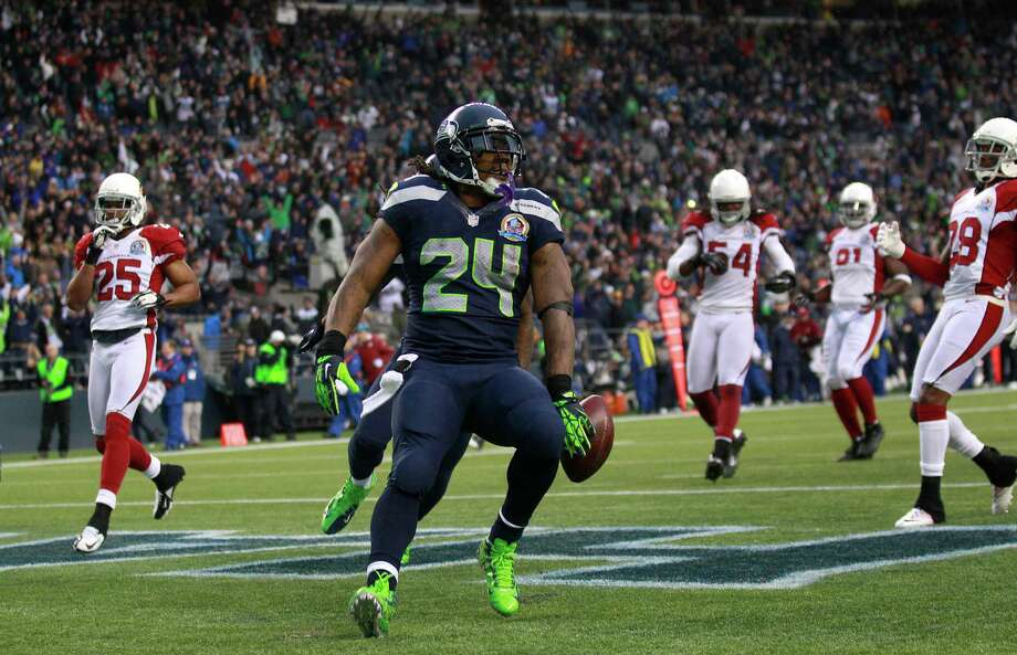 Seattle Seahawks running back Marshawn Lynch (24) scores on a 33-yard touchdown against the Arizona Cardinals during the third quarterof an NFL football game in Seattle, Sunday, Dec. 9, 2012. Photo: AP
