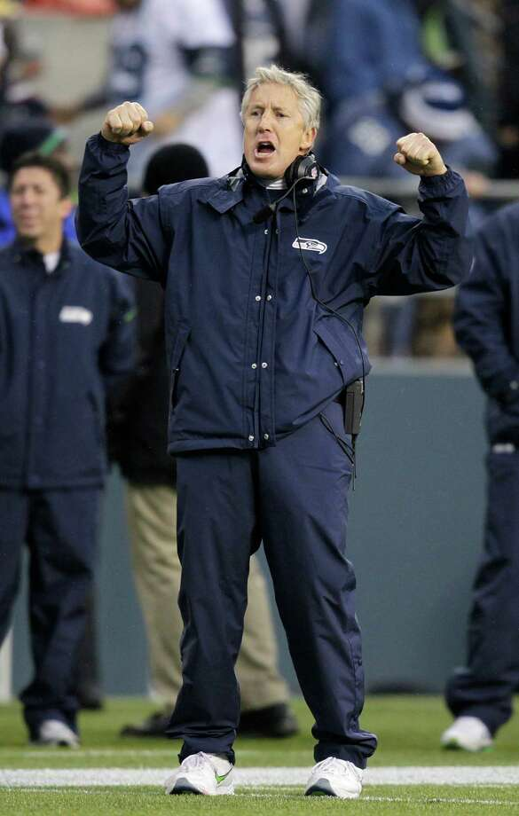 Seattle Seahawks head coach Pete Carroll celebrates against the Arizona Cardinals during the third quarter of an NFL football game in Seattle, Sunday, Dec. 9, 2012. Photo: AP