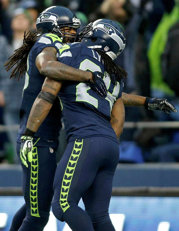 Seattle Seahawks running back Marshawn Lynch (24) is congratulated by wide receiver Sidney Rice after scoring on a 33-yard touchdown run against the Arizona Cardinals during the third quarter of an NFL football game in Seattle, Sunday, Dec. 9, 2012. Photo: AP