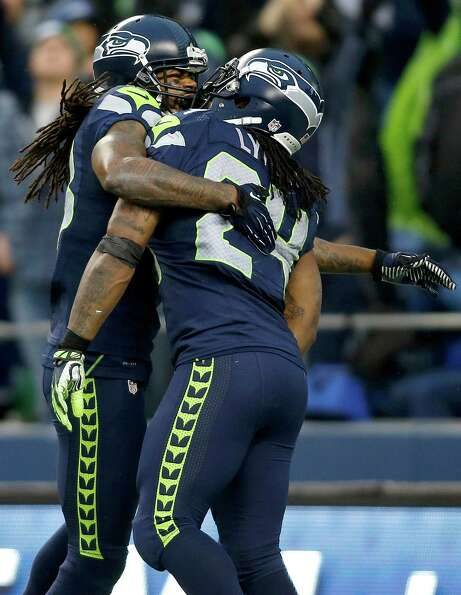Seattle Seahawks running back Marshawn Lynch (24) is congratulated by wide receiver Sidney Rice afte