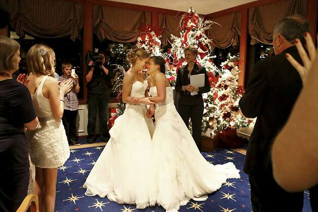 Mary Davidson, 27, left, and Monica Rozgay, 29, smile after saying 'I do' at their midnight wedding at The Seattle Yacht Club early Sunday, Dec. 9, 2012, in Seattle. Rozgay and Davidson, of Seattle, are one of the first couples to wed following the passage of Referendum 74, which approved a bill legalizing same-sex marriage in the state of Washington. Washington Gov. Chris Gregoire and Secretary of State Sam Reed certified the election results of the referendum on Dec. 5. (AP Photo/The Seattle Times, Bettina Hansen) MAGS OUT; USA TODAY OUT; NO SALES; SEATTLEPI.COM OUT; MANDATORY CREDIT Photo: Bettina Hansen, Associated Press