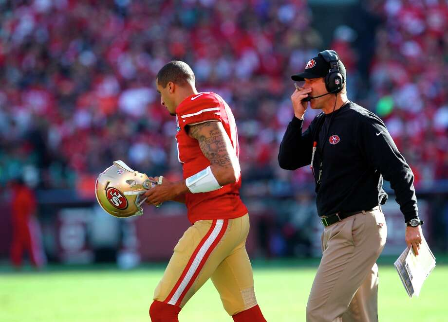 Quarterback Colin Kaepernick (7) and coach Jim Harbaugh during the first half of the San Francisco 49ers game against the Miami Dolphins at Candlestick Park in San Francisco, Calif., on Sunday December 9, 2012. Photo: Carlos Avila Gonzalez, The Chronicle / ONLINE_YES