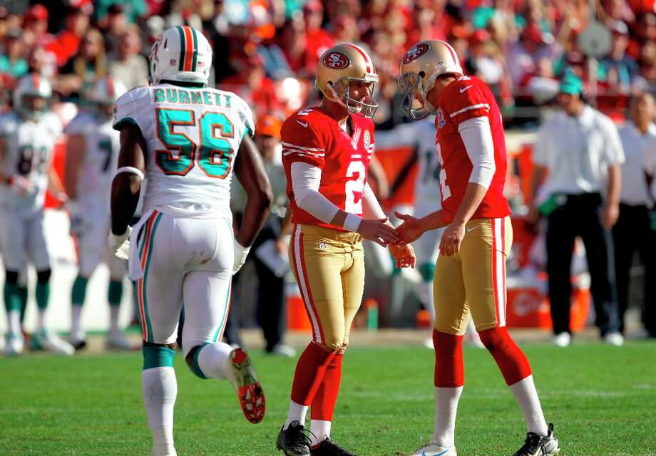 Kicker David Akers (2) after kicking a field goal with Punter Andy Lee (4) in the second quarter of the San Francisco 49ers game against the Miami Dolphins at Candlestick Park in San Francisco, Calif., on Sunday December 9, 2012. Photo: Carlos Avila Gonzalez, The Chronicle / ONLINE_YES