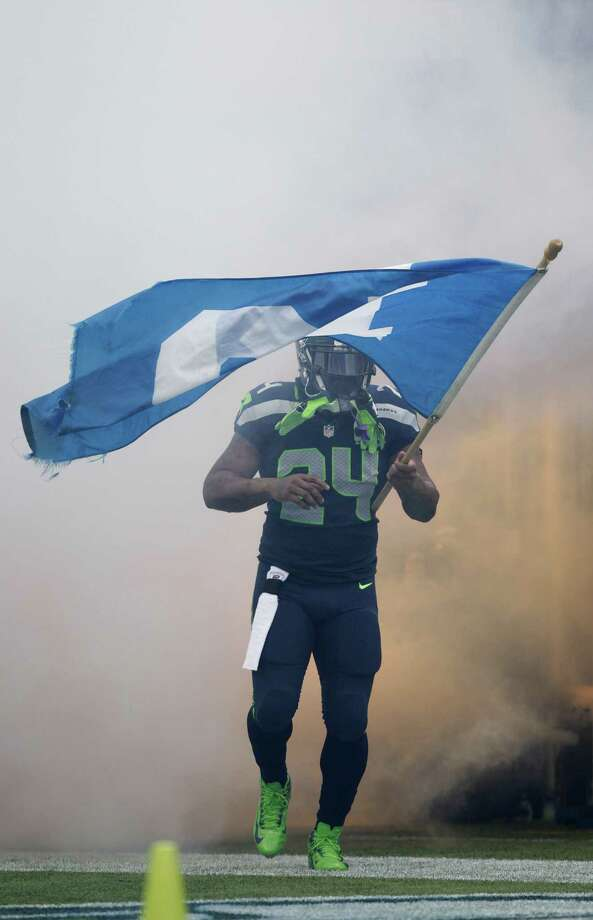 Seattle Seahawks running back Marshawn Lynch (24) is introduced before an NFL football game against the Arizona Cardinals in Seattle, Sunday, Dec. 9, 2012. Photo: AP