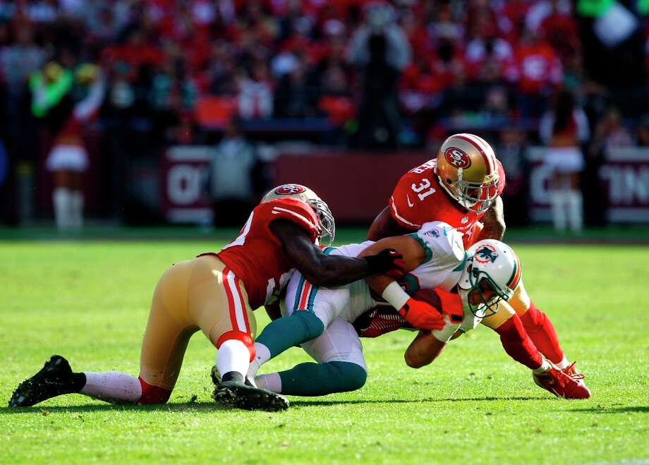Linebacker Patrick Willis (52) and Safety Donte Whitner (31) in the second quarter of the San Francisco 49ers game against the Miami Dolphins at Candlestick Park in San Francisco, Calif., on Sunday December 9, 2012. Photo: Carlos Avila Gonzalez, The Chronicle / ONLINE_YES