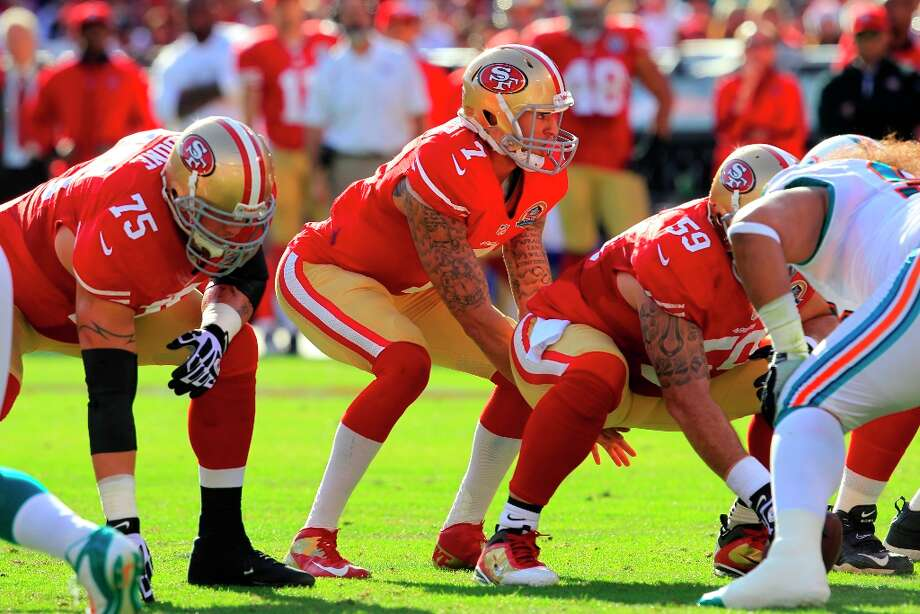 Quarterback Colin Kaepernick (7) and Offensive tackle Alex Boone (75) and Center Jonathan Goodwin (59) on the line of scrimmage in the second quarter of the San Francisco 49ers game against the Miami Dolphins at Candlestick Park in San Francisco, Calif., on Sunday December 9, 2012. Photo: Brant Ward, The Chronicle / ONLINE_YES