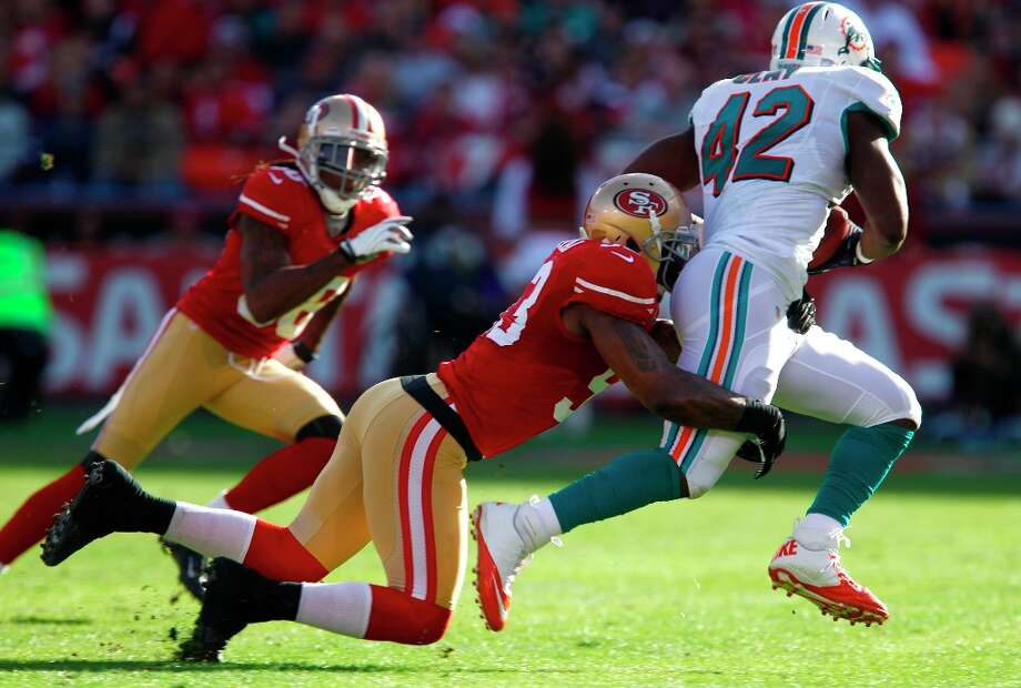 Linebacker NaVorro Bowman (53 takes down Miami fullback Charles Clay (42) in the second quarter of the San Francisco 49ers game against the Miami Dolphins at Candlestick Park in San Francisco, Calif., on Sunday December 9, 2012. Photo: Carlos Avila Gonzalez, The Chronicle / ONLINE_YES