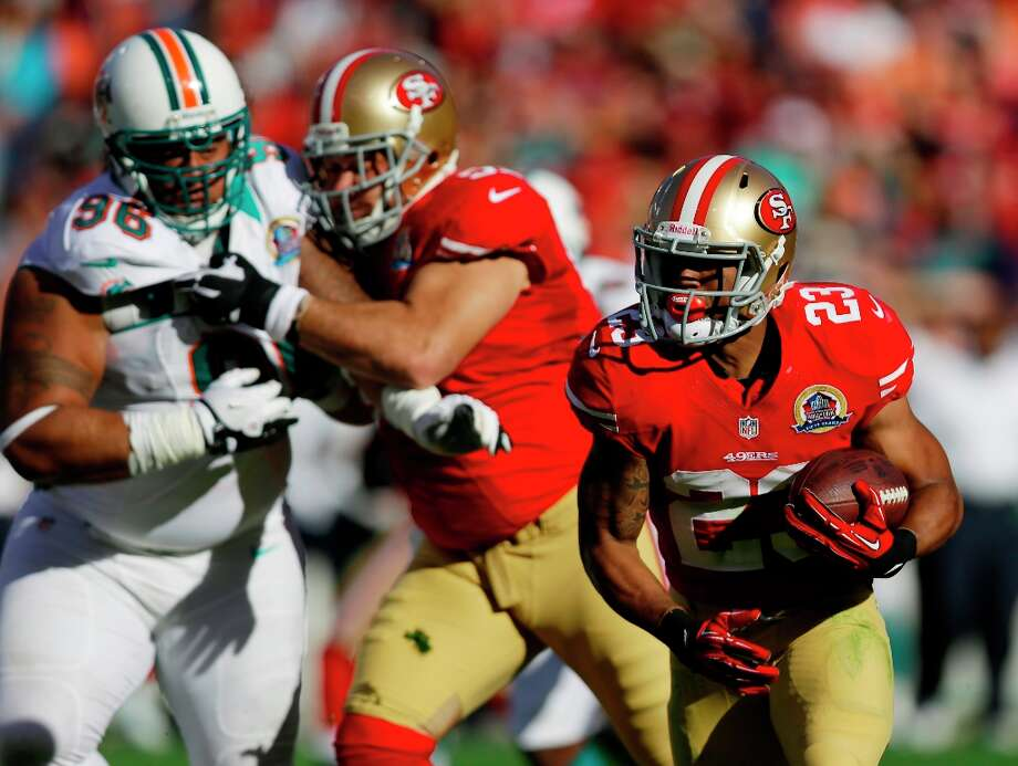 San Francisco 49ers running back LaMichael James carries the ball past Miami Dolphins defensive tackle Paul Soliai (96) during the first quarter of an NFL football game in San Francisco, Sunday, Dec. 9, 2012. (AP Photo/Marcio Jose Sanchez) Photo: Marcio Jose Sanchez, Associated Press / AP