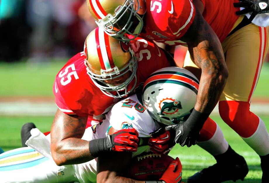 Linebacker Ahmad Brooks (55) and Linebacker NaVorro Bowman (53) take down Miami running back Lamar Miller (26) during the first quarter of the San Francisco 49ers game against the Miami Dolphins at Candlestick Park in San Francisco, Calif., on Sunday December 9, 2012. Photo: Sean Culligan, Special To The Chronicle / ONLINE_YES