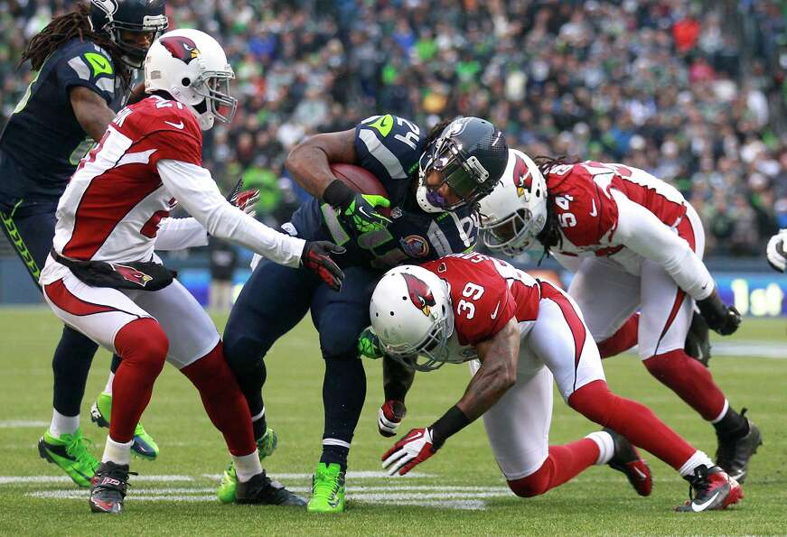 Seattle Seahawks running back Marshawn Lynch (24) runs against Arizona Cardinals cornerback Patrick