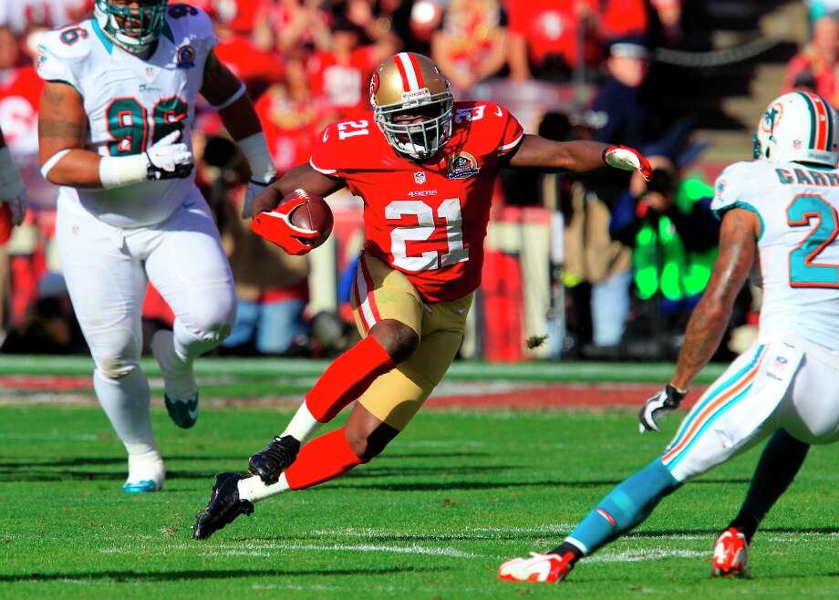 Running back Frank Gore (21) runs for a first down  during the first quarter of the San Francisco 49ers game against the Miami Dolphins at Candlestick Park in San Francisco, Calif., on Sunday December 9, 2012. Photo: Brant Ward, The Chronicle / ONLINE_YES