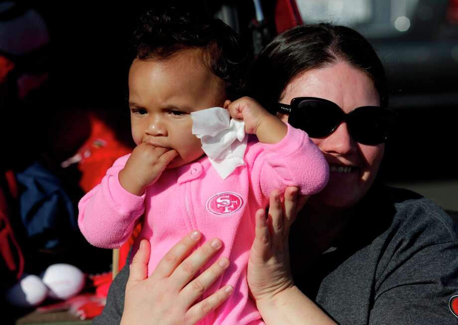 Baby Niners fan Jayla Bradley with her mother before the San Francisco 49ers game against the Miami Dolphins at Candlestick Park in San Francisco, Calif., on Sunday December 9, 2012. Photo: Brant Ward, The Chronicle / ONLINE_YES