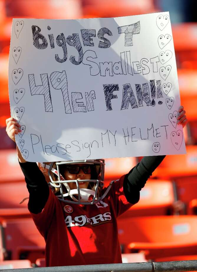 San Francisco 49ers fan Amaya Castillo holds up a sign before the start of an NFL football game against the Miami Dolphins in San Francisco, Sunday, Dec. 9, 2012. Photo: Marcio Jose Sanchez, Associated Press / AP