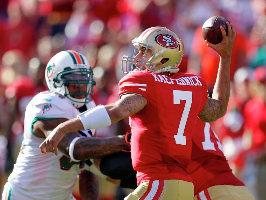 San Francisco 49ers quarterback Colin Kaepernick drops back to pass during the first quarter of an NFL football game against the Miami Dolphins in San Francisco, Sunday, Dec. 9, 2012. Photo: Ben Margot, Associated Press / AP