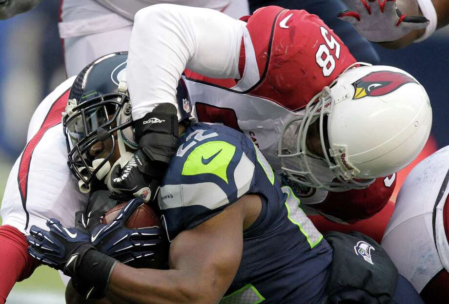 Arizona Cardinals inside linebacker Daryl Washington (58) tackles Seattle Seahawks running back Robert Turbin (22) during the first half of an NFL football game in Seattle, Sunday, Dec. 9, 2012. Photo: AP