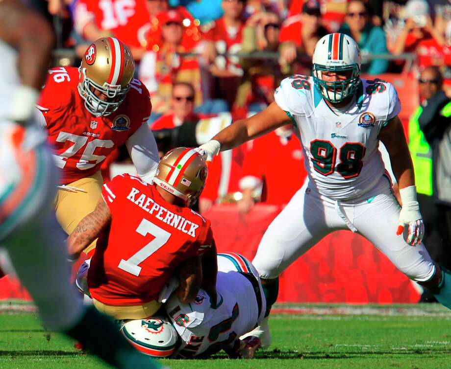 Quarterback Colin Kaepernick (7) is sacked for a 5 yard loss in the first quarter of the San Francisco 49ers game against the Miami Dolphins at Candlestick Park in San Francisco, Calif., on Sunday December 9, 2012. Photo: Brant Ward, The Chronicle / ONLINE_YES