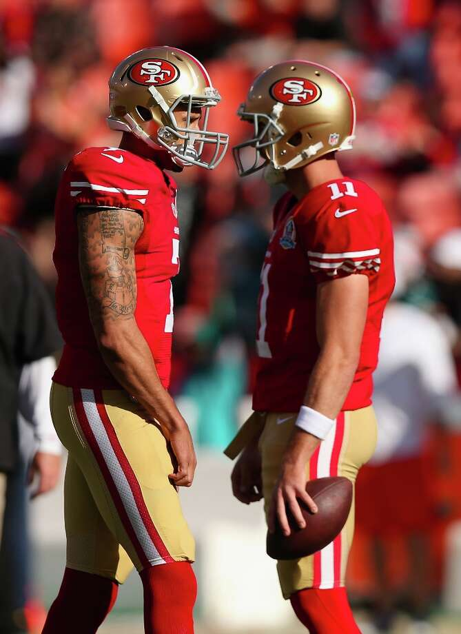 Quarterbacks Colin Kaepernick (7) and Alex Smith (11) of the San Francisco 49ers take warm ups before their game against the Miami Dolphins at Candlestick Park on December 9, 2012 in San Francisco, California. Photo: Ezra Shaw, Getty Images / 2012 Getty Images