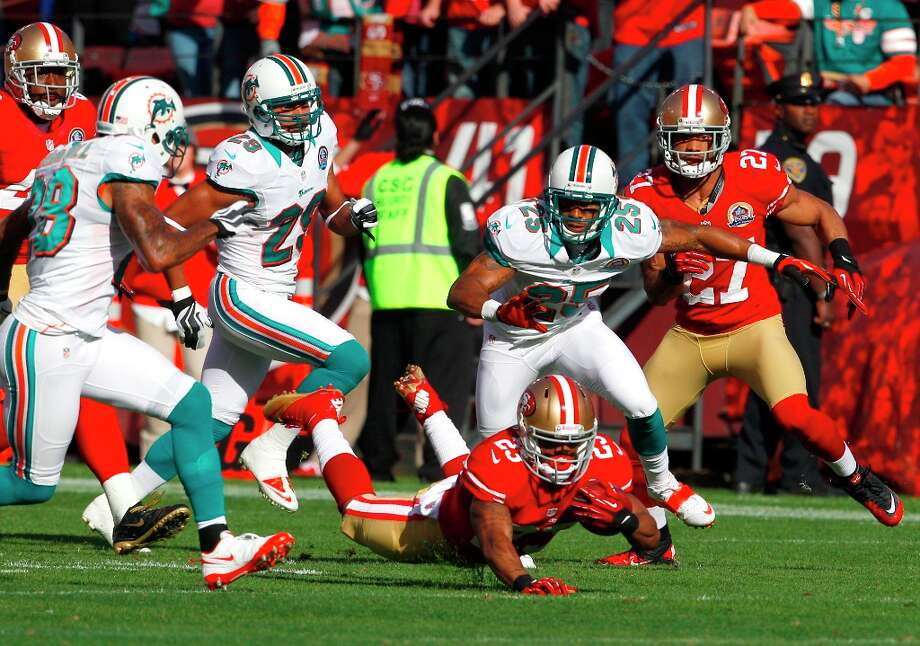 Running back LaMichael James (23) is down during the first quarter of the San Francisco 49ers game against the Miami Dolphins at Candlestick Park in San Francisco, Calif., on Sunday December 9, 2012. Photo: Carlos Avila Gonzalez, The Chronicle / ONLINE_YES