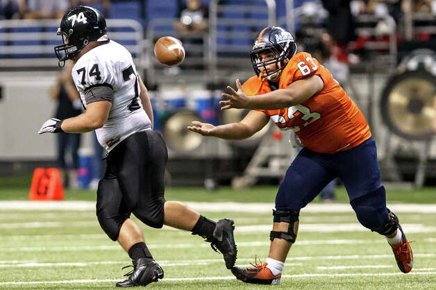 Brandeis offensive lineman Arturo Fuentes (right) tries to catch a tipped pass during the third quarter of heir Class 5A Division II state quarterfinal game with Steele at the Alamodome on Dec. 8, 2012.  Steele won the game 28-12.   MARVIN PFEIFFER/ mpfeiffer@express-news.net Photo: MARVIN PFEIFFER, Marvin Pfeiffer/ Express-News / Express-News 2012