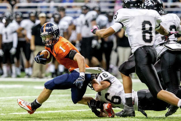 Brandeis' Trinton Ynclan tries to escape the grasp of Steele's Tyler Petoskey as Jalen Maddox (right) and John Burton come on to help during the third quarter of their Class 5A Division II state quarterfinal game at the Alamodome on Dec. 8, 2012.  Steele won the game 28-12.   MARVIN PFEIFFER/ mpfeiffer@express-news.net Photo: MARVIN PFEIFFER, Marvin Pfeiffer/ Express-News / Express-News 2012
