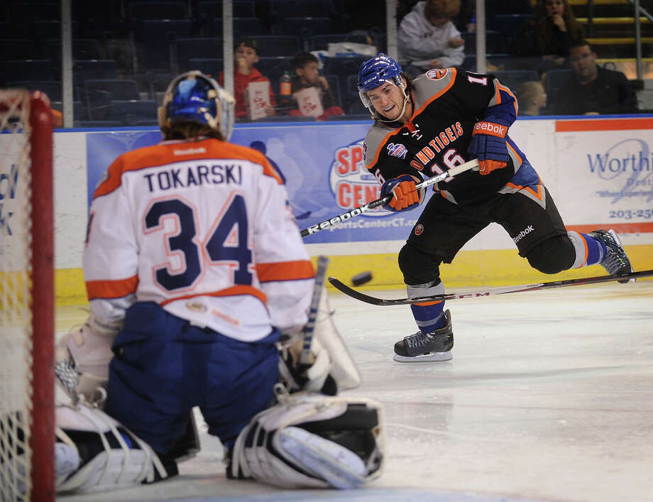 Sound Tiger Sean Backman fires a shot on Syracuse goalie Dustin Tokarski during the second period of their AHL matchup at the Webster Bank Arena in Bridgeport on Sunday, December 9, 2012. Photo: Brian A. Pounds / Connecticut Post