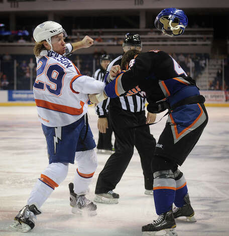Syracuse's Eric Neilson throw a punch at Sound Tiger Brett Gallant as Gallant's helmet flies off during the second period of their AHL matchup at the Webster Bank Arena in Bridgeport on Sunday, December 9, 2012. Photo: Brian A. Pounds / Connecticut Post