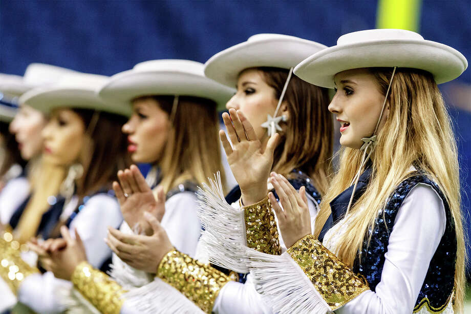 The O'Connor Gold Dusters sing the school song prior to their Class 5A Division I state quarterfinal game with Madison at the Alamodome on Dec. 8, 2012.  MARVIN PFEIFFER/ mpfeiffer@express-news.net Photo: MARVIN PFEIFFER, Marvin Pfeiffer/ Express-News / Express-News 2012