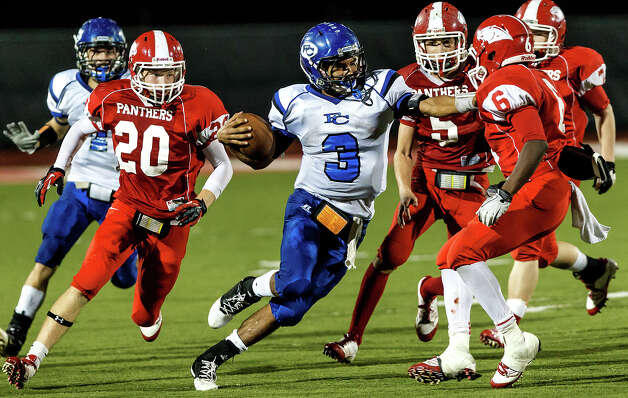 Falls City quarterback Camerson Soto (center) splits the Burton defense on his way to a 52-yard touchdown in the fourth quarter of their Class A Division II state quarterfinal game at Rutledge Stadium on Dec. 7, 2012.  Falls City won the game 29-7.  MARVIN PFEIFFER/ mpfeiffer@express-news.net Photo: MARVIN PFEIFFER, Marvin Pfeiffer/ Express-News / Express-News 2012