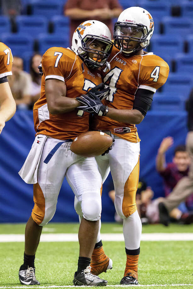 Madison's Marquis Warford (left) celebrates a third quarter touchdown with Byron Daniels during their Class 5A Division I state quarterfinal game with O'Connor at the Alamodome on Dec. 8, 2012.  O'Connor beat the Mavericks 52-49.  MARVIN PFEIFFER/ mpfeiffer@express-news.net Photo: MARVIN PFEIFFER, Marvin Pfeiffer/ Express-News / Express-News 2012