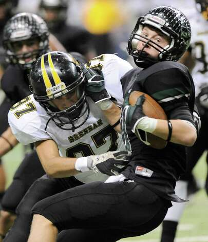Brennan's James Hamilton, left, tackles Cedar Park's Lane Waller during the first half of a 4A high school football playoff game, Friday, Dec. 7, 2012, at the Alamodome in San Antonio. Photo: Darren Abate, Darren Abate/For The Express-New