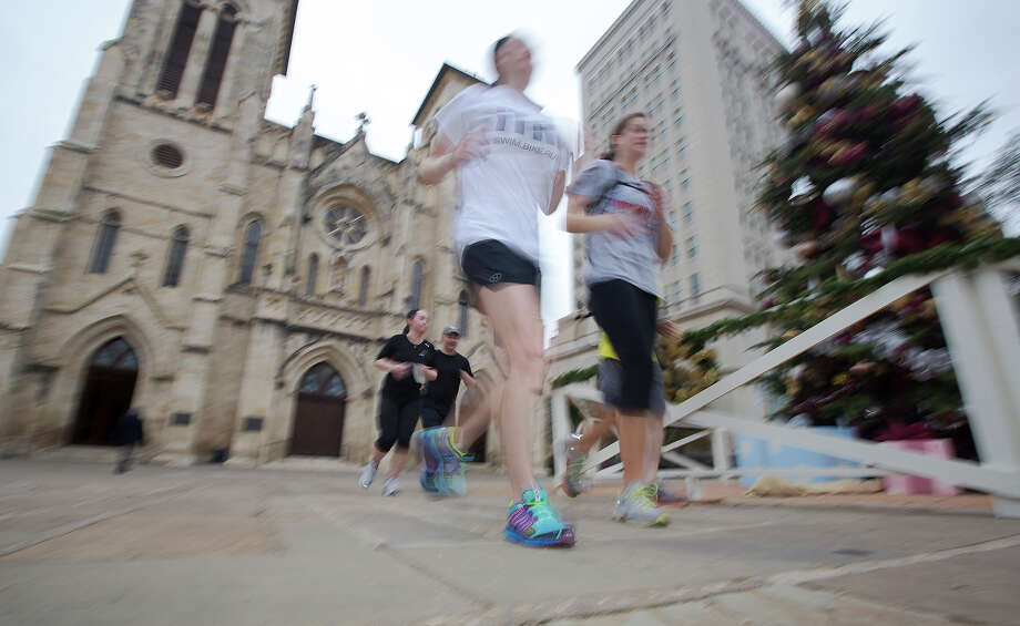 Through Dec. 29:  Meet in front of the Alamo for a guided running tour that takes place every Saturday and Sunday at 8 a.m. There are 15 stops along the way where guides share interesting and historical information about downtown sites - rivercityrunsa.com Photo: Michael Miller, For The Express-News  / © San Antonio Express-News