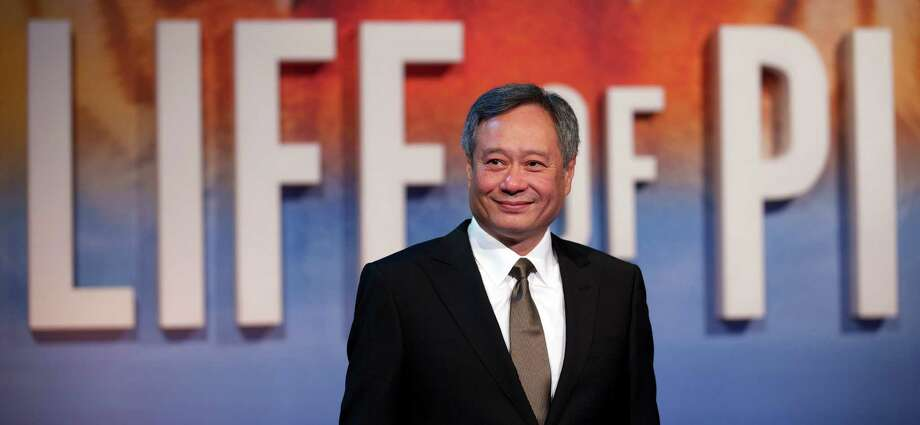 "Best director contender, Ang Lee for ""Life of Pi"" Photo: Lee poses for pictures on the red carpet as he arrives for the UK premier of ""Life of Pi"" at the Empire cinema, central London, on Dec. 3, 2012. Photo: Andrew Cowie, AFP / Getty Images / Andrew Cowie"