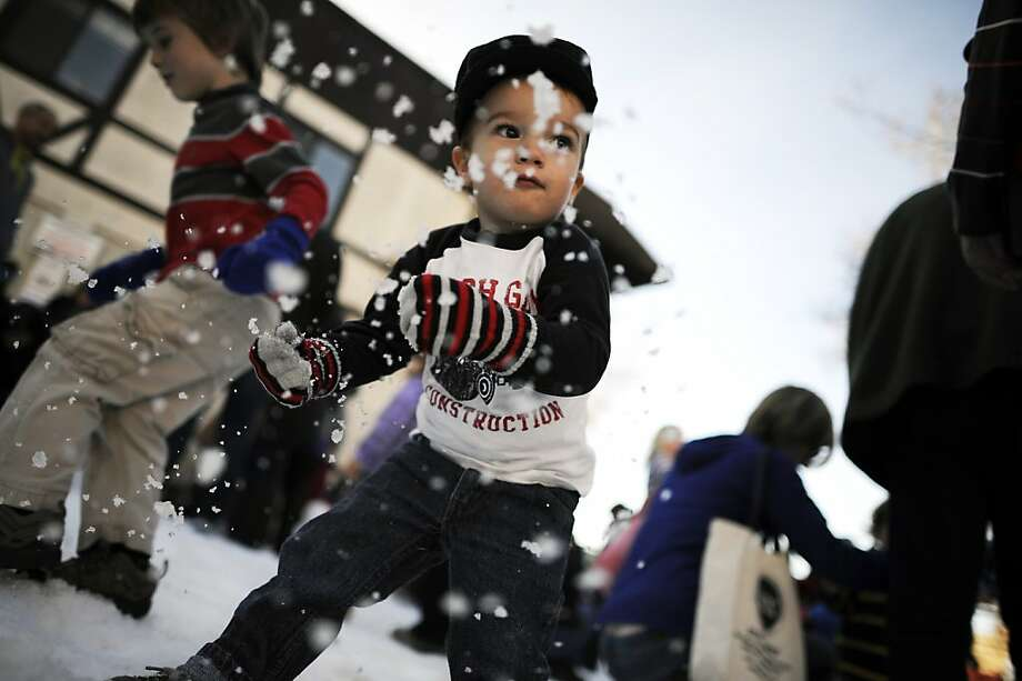 Ollie Bowman, 1 1/2, helped build and then smash a snowman - a rare treat for a boy from Castro Valley. Photo: Michael Short, Special To The Chronicle