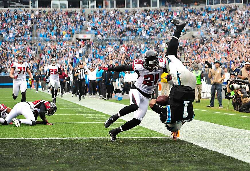 Carolina quarterback Cam Newton somersaults into the end zone in front of Atlanta's Christopher Owen