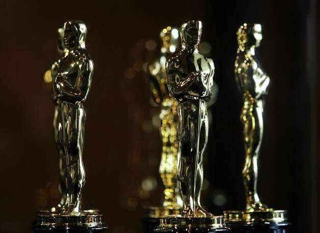 "The coming Oscar race could pit FDR against Lincoln, both competing with Alfred Hitchcock for best actor honors. That would be, respectively, Bill Murray, Daniel Day-Lewis and Anthony Hopkins losing themselves in their larger-than-life roles.  For a movie year that started sluggishly, it sure has picked up. Fall favorites ""Cloud Atlas"" and ""The Master"" have been replaced by robust contenders such as ""Lincoln"" and ""Life of Pi.""  So many men have turned in astonishing performances it is difficult to narrow the actor categories to five each. Nominees in the actress division are being chosen from a smaller pool. Many will be receiving their first nomination. But Day-Lewis, Denzel Washington and Sally Field each could be chasing a third Oscar, which would put them in rarefied company.  Academy Award nominations will be announced Jan. 10. Click through to see the leading contenders in the top categories.  Words by Ruthe Stein, San Francisco Chronicle movie correspondent Photo: Gabriel Bouys, AFP / Getty Images / 2008 AFP"