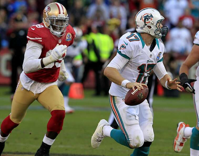 The heat is on Miami quarterback Ryan Tannehill as 49ers linebacker Aldon Smith zeroes in.