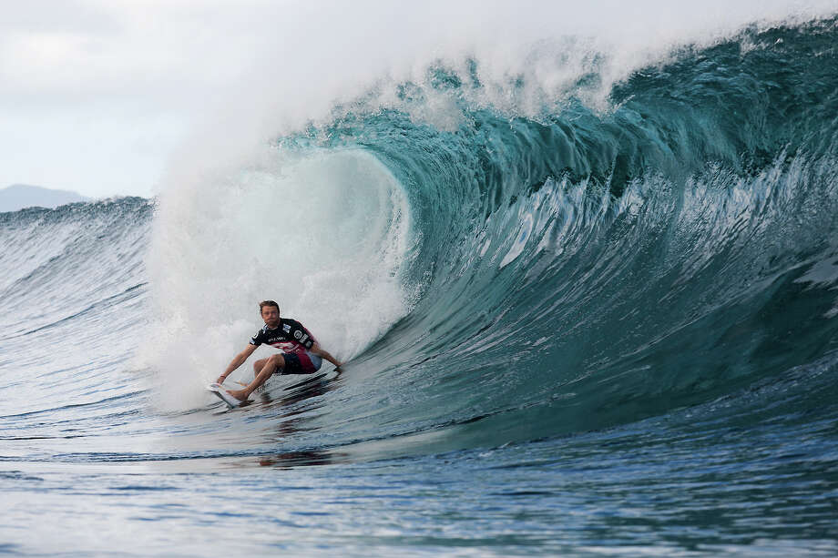 In this photo provided by Associated of Surfing Professionals, Dane Reynolds competes on the way to advancing into the fourth round of the Billabong Pipe Masters in Memory of Andy Irons surfing event, Sunday, Dec. 9, 2012, in Oahu, Hawaii. (AP Photo/Associated of Surfing Professionals, Kelly Cestari) Photo: Kelly Cestari