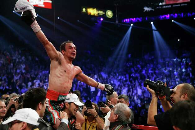 Juan Manuel Marquez, from Mexico, left, celebrates his win over Manny Pacquiao in their WBO world welterweight  fight Saturday, Dec. 8, 2012, in Las Vegas.  (AP Photo/Eric Jamison) Photo: Eric Jamison