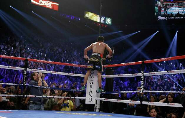 Juan Manuel Marquez, from Mexico celebrates his win over Manny Pacquiao in their WBO world welterweight  fight Saturday, Dec. 8, 2012, in Las Vegas. (AP Photo/Julie Jacobson) Photo: Julie Jacobson