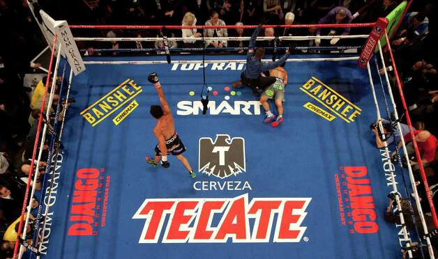 Juan Manuel Marquez, left, begins to celebrate as referee Kenny Bayless calls Manny Pacquiao down for the count in the sixth round during a WBO welterweight fight, Saturday, Dec. 8, 2012, in Las Vegas. (AP Photo/Julie Jacobson) Photo: Julie Jacobson